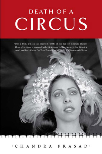 White and black text stating Death of a Circus by Chandra Prasad over a red background with the black and white image of a woman in a headdress underneath.