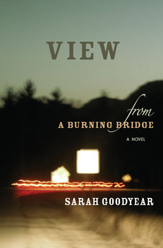 Grey, yellow, and white text stating View from a Burning Bridge a novel by Sarah Goodyear over the blurred image of a bridge with orange lights.
