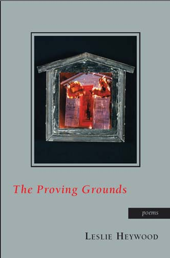 Red and black text stating The Proving Grounds poems by Leslie Heywood over a grey background with the image of a burning house.