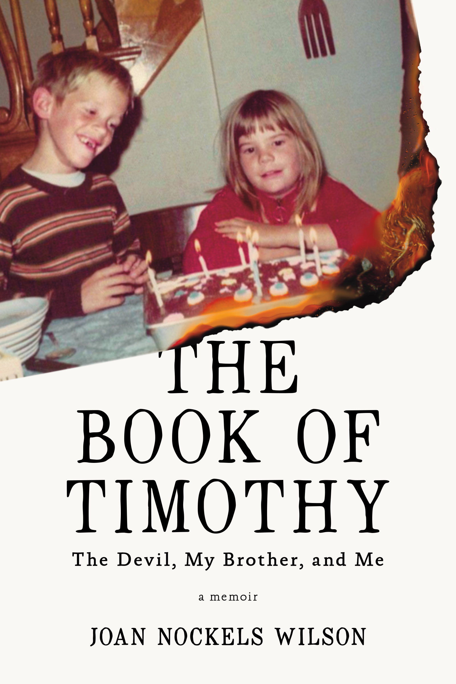 An off-white cover with black script in the center that reads The Book of Timothy: The Devil, My Brother and Me a memoir by Joan Nockels Wilson, with a photograph at the top of a brother and sister sitting around a birthday cake.